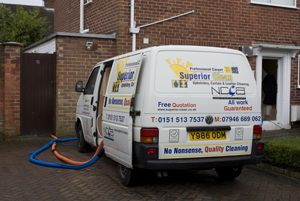 Our truck mounted carpet cleaning machine with hoses running into a customers house to clean all carpets.